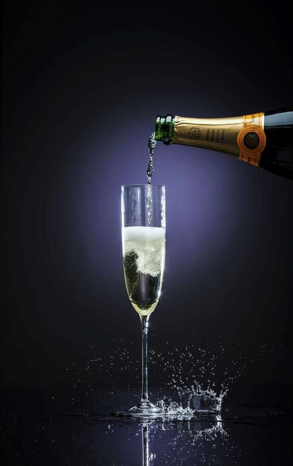 Your average four ounce glass of champagne has around 84 calories and is equal to ... Photo: Michael Paulsen, Staff / © 2012 Houston Chronicle