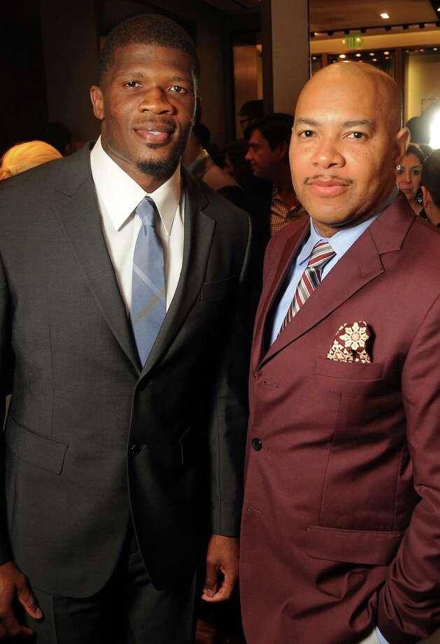 Andre Johnson, left, and Reggie Saunders Photo: Dave Rossman, Freelance / © 2012 Dave Rossman