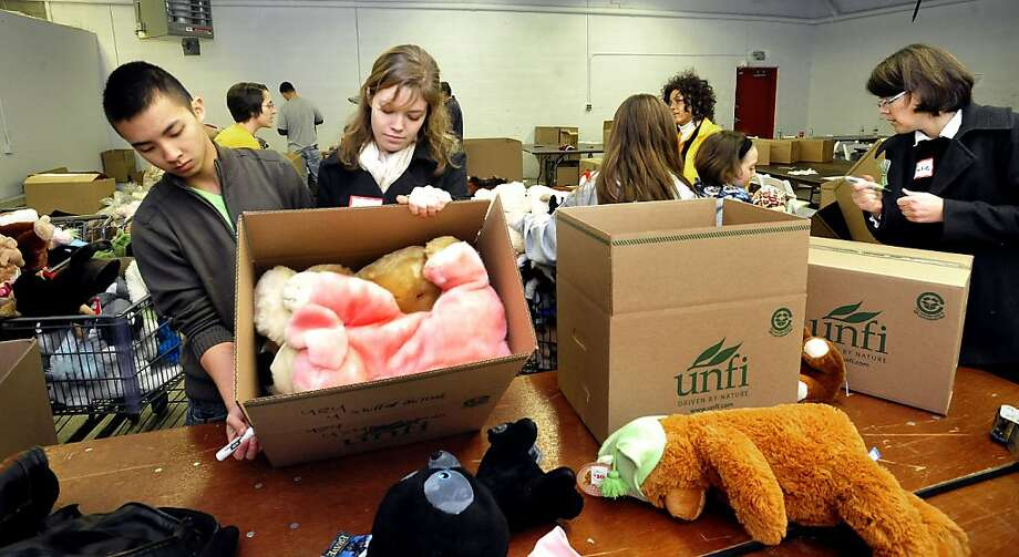 Volunteers pack up stuffed animals sent to Newtown, Conn., in the wake of the shooting. Photo: Michael Duffy