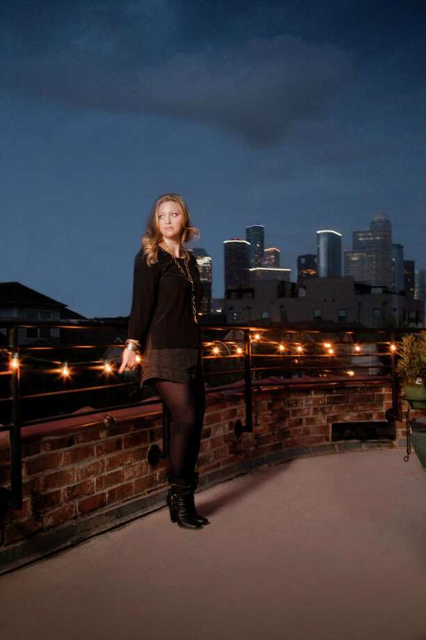 Professional photographer Julie Soefer on the third-floor roof deck of her Montrose home. Photo: Adriel Salazar, Style Home Soefer / © Julie Soefer