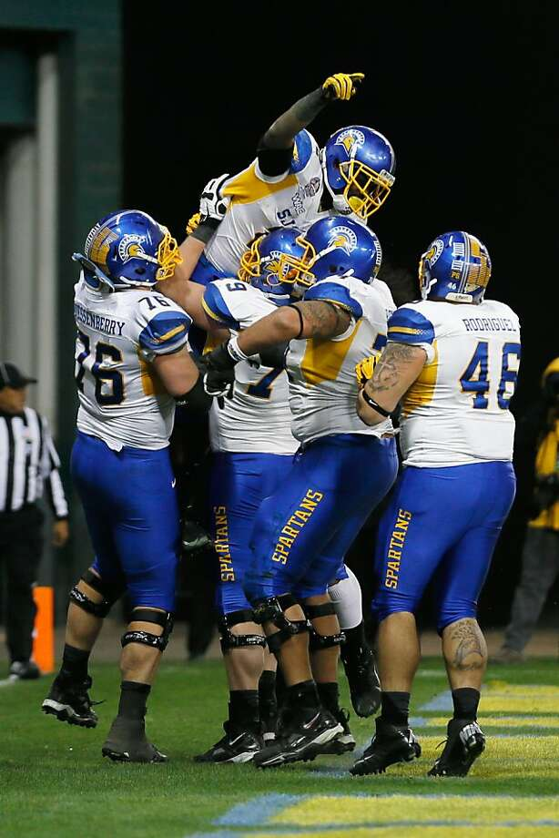 De'Leon Eskridge gets a lift from his San Jose State teammates after scoring an insurance touchdown in the fourth quarter. Photo: Rob Carr, Getty Images