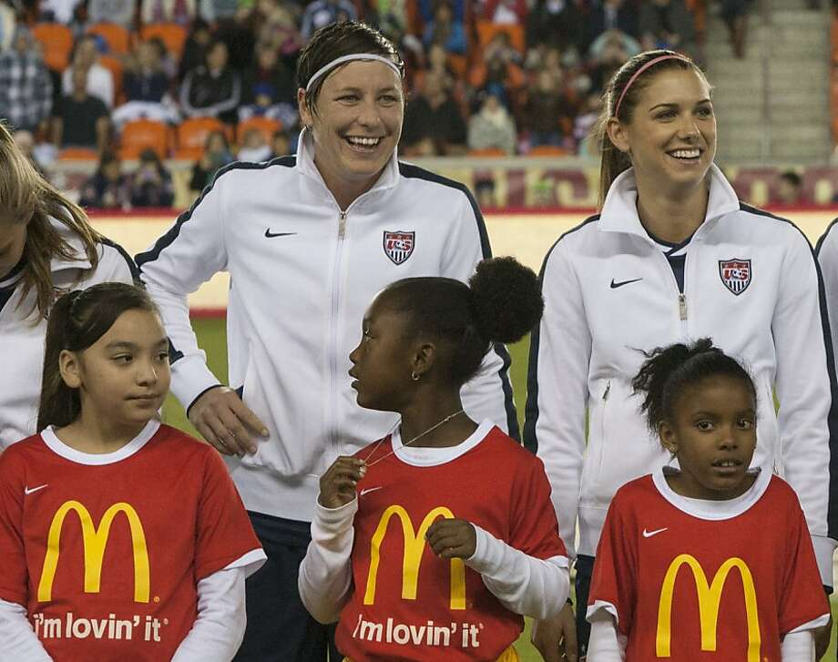 U.S. teammates Abby Wambach (left) and Alex Morgan are women's Ballon D'Or finalists. Photo: Bob Levey, Getty Images