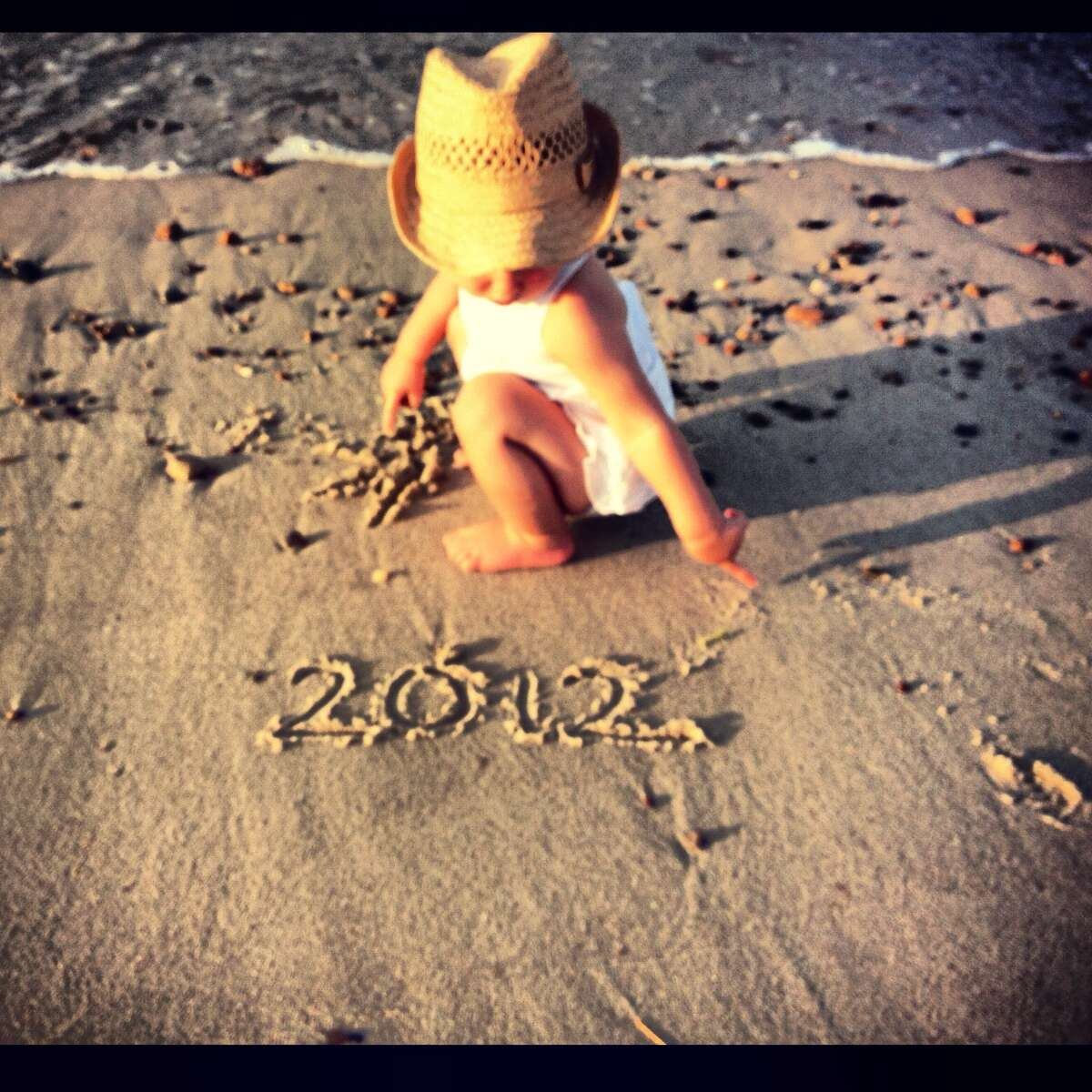 Olivia Stickles thinks ahead as she signs off on 2012. She was 14-months old in August during the family vacation with mom and dad, Jessica and David, to Cape Cod. It was a special trip because it was the last vacation with just the three family members ? little brother Jackson came along on Nov. 14. ?All of us have had an amazing 2012 and are looking forward to 2013,? David says. (David Stickles)