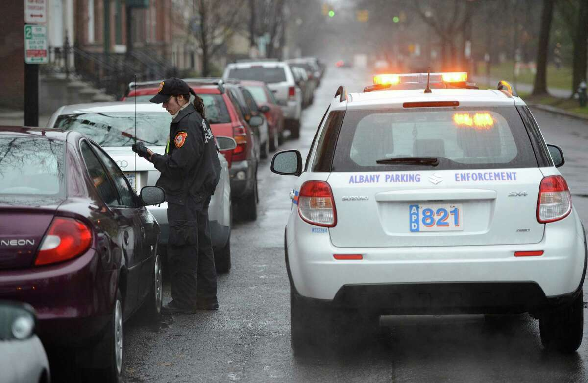 Public Service Officer Trisha Lossi checks for parking violators with the city's new Suzuki on State Street in Albany, N.Y. Dec 18, 2012. (Skip Dickstein/Times Union)