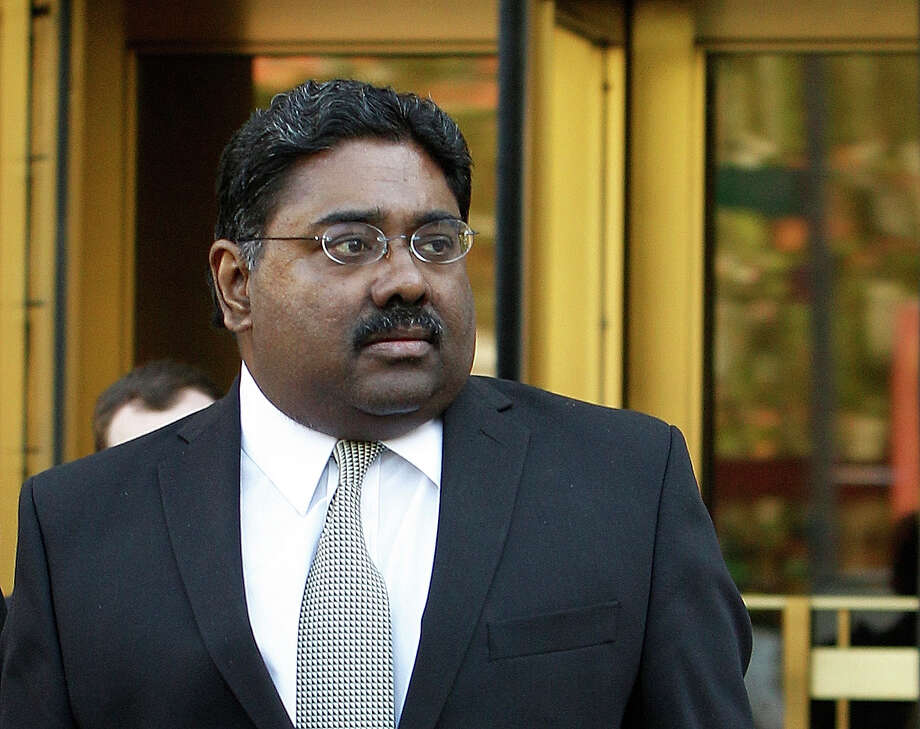 FILE- In this May 10, 2011 file photo,  Raj Rajaratnam co-founder of  Galleon hedge fund group leaves U.S. District Court after jury deliberations in New York. U.S. District Judge Jed Rakoff imposed a record $92 million civil penalty on Rajaratnam, Tuesday, Nov. 8, 2011 saying his insider trading scheme ?cries out for the kind of civil penalty that will deprive him of a material part of his fortune. Rajaratnam was convicted in 2011 for insider trading and was sentenced in October to 11 years in prison. (AP Photo/Kathy Willens, Flie) Photo: Kathy Willens, STF / AP2011
