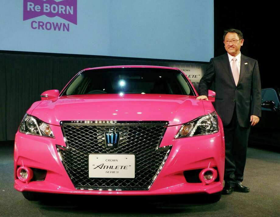 In this Tuesday, Dec. 25, 2012 photo,  Toyota Motor Corp. President Akio Toyoda smiles as he shows a remodeled Crown sedan in Tokyo. Toyota expects to sell a record 9.7 million vehicles this year, bouncing back by 22 percent from a disaster-struck 2011. It has set an even higher target of 9.91 million vehicles for 2013. The numbers released this week underline Toyota's solid turnaround from supply disruptions caused by the earthquake and tsunami in northeastern Japan in 2011 that had hurt global production and sales. (AP Photo/Kyodo News) JAPAN OUT, MANDATORY CREDIT, NO LICENSING IN CHINA, HONG KONG, JAPAN, SOUTH KOREA AND FRANCE Photo: SUB / Kyodo News