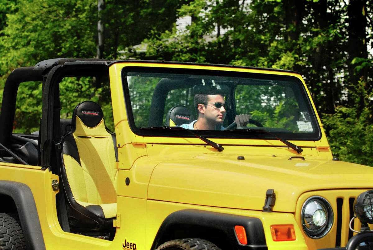Christopher Porco drives his yellow 2004 Jeep up Edgmont Court in Delmar, N.Y., Thursday June 22, 2006. (Michael P. Farrell/Times Union)