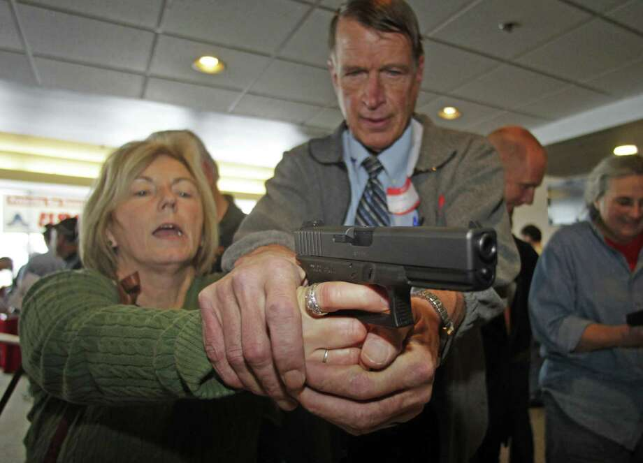 Christine Caldwell gets firearms training during concealed weapons training for 200 Utah teachers. Photo: Rick Bowmer, STF / AP