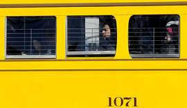 Streetcar 1071 carries passengers along the Embarcadero in San Francisco, Calif. on Thursday Dec. 27, 2012. San Francisco's Municipal Railway is celebrating it 100th anniversary tomorrow..