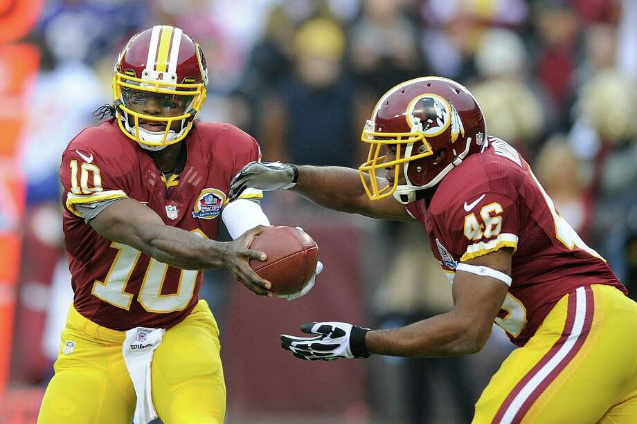 The Redskins' tandem of quarterback Robert Griffin III and running back Alfred Morris poses a problem for the Cowboys in the clash for the NFC East crown. Photo: Nick Wass, FRE / FR67404 AP