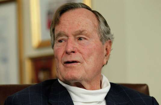 FILE - DECEMBER 26: Former U.S. President George H.W. Bush has been in and out of the hospital in Houston since early November his spokesman said on December 26, 2012, and spent Christmas in the hospital with a rising fever.  HOUSTON, TX - MARCH 29:   Former President George H.W. Bush talks with Republican presidential candidate, former Massachusetts Gov. Mitt Romney at Bush's office on March 29, 2012 in Houston, Texas. Mitt Romney received an endorsement from Former President George H.W. Bush and Barbara Bush during the meeting. Photo: Tom Pennington, Getty Images / 2012 Getty Images