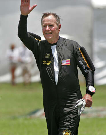 Former President George H. W. Bush greets the crowd after competing his parachute jump in celebration of his 80th birthday in College Station, Texas on Sunday, June 13, 2004. (Joyce Marshall/Fort Worth Star-Telegram/MCT) Photo: Joyce Marshall, McClatchy-Tribune News Service / Fort Worth Star-Telegram