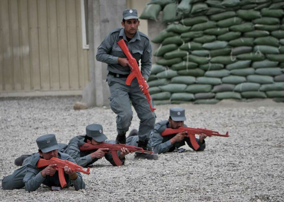 Afghan police officers show their skills during a graduation ceremony at a National Police training center in Jalalabad. Afghan police officers have suffered the most in insider killings, the latest of which have involved attacks after the officers are asleep and some when drugged. Photo: Rahmat Gul, STR / AP