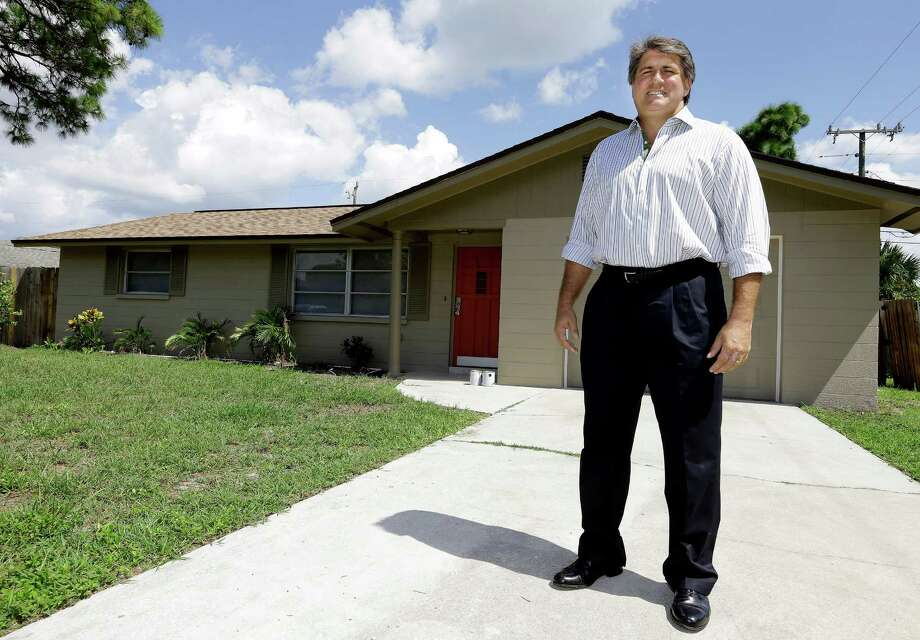 In this Sept. 12, 2012, photo, Andrew Neitlich poses in front of one his investment homes in Venice, Fla. Neitlich once worked as a financial analyst picking stocks for a mutual fund. During the dot-com crash 12 years ago, Neitlich didn't sell his stocks, but like many others he is selling now.  An analysis by The Associated Press finds that individual investors have pulled at least $380 billion from U.S. stock funds since they started selling in April 2007.  (AP Photo/Chris O'Meara) Photo: Chris O'Meara, Associated Press / Associated Press