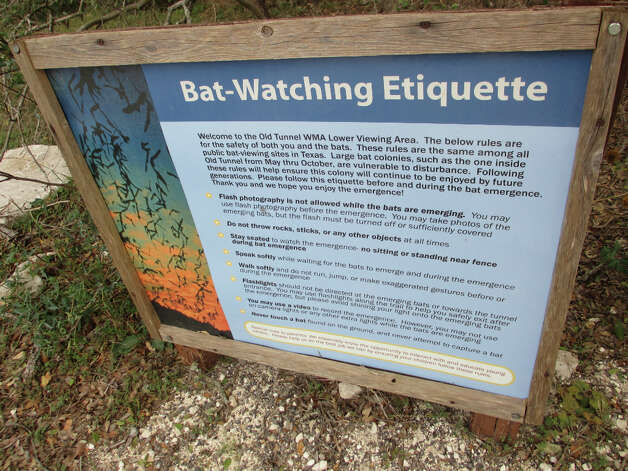 A sign on the trail at Old Tunnel State Park gives visitors tips on bat viewing etiquette. (Terry Scott Bertling / San Antonio Express-News)