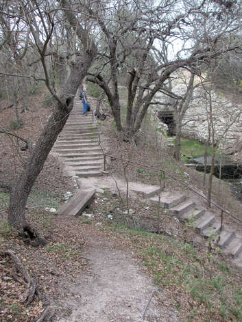 A short trail in Old Tunnel State Park takes visitors down stairs and up a steep hill, but the short path is a good place to birdwatch. (Terry Scott Bertling / San Antonio Express-News)