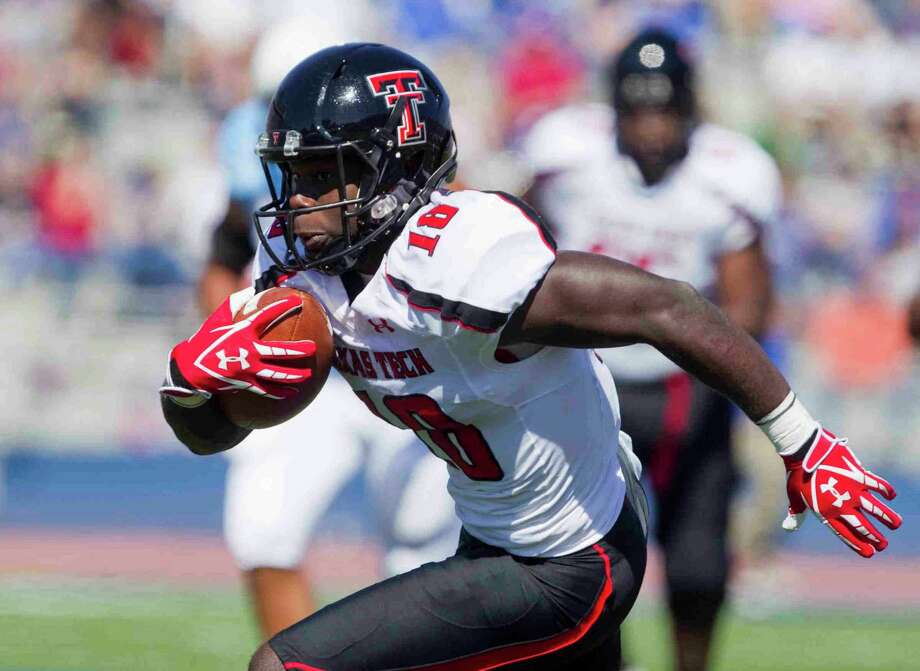 Texas Tech wide receiver Eric Ward (18) turns the corner and heads for the end zone to socre in the first quarter against Kansas at the University of Kansas Memorial Stadium on Saturday, Octotber 1, 2011, in Lawrence, Kansas. Texas Tech prevailed, 45-34. (Shane Keyser/Kansas City Star/MCT) Photo: Shane Keyser, MBR / Kansas City Star