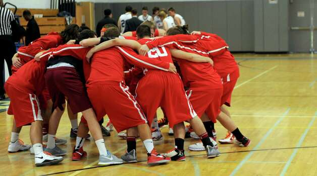 Greenwich players gather in a huddle before competing against Darien High School in the Tony LaVista Tournament on Thursday, December 27, 2012, at Darien High School. Photo: Lindsay Niegelberg, Niegelberg / Stamford Advocate