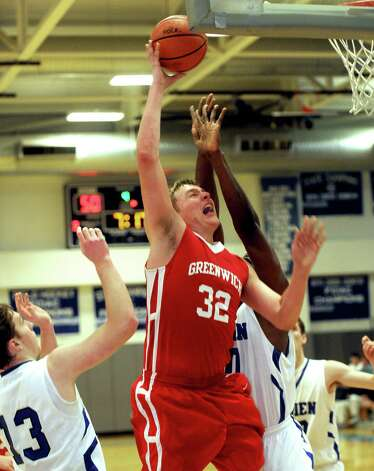 Greenwich's Alex Wolf takes a shot during the Tony LaVista Tournament against Darien on Thursday, December 27, 2012, at Darien High School. Photo: Lindsay Niegelberg, Niegelberg / Stamford Advocate