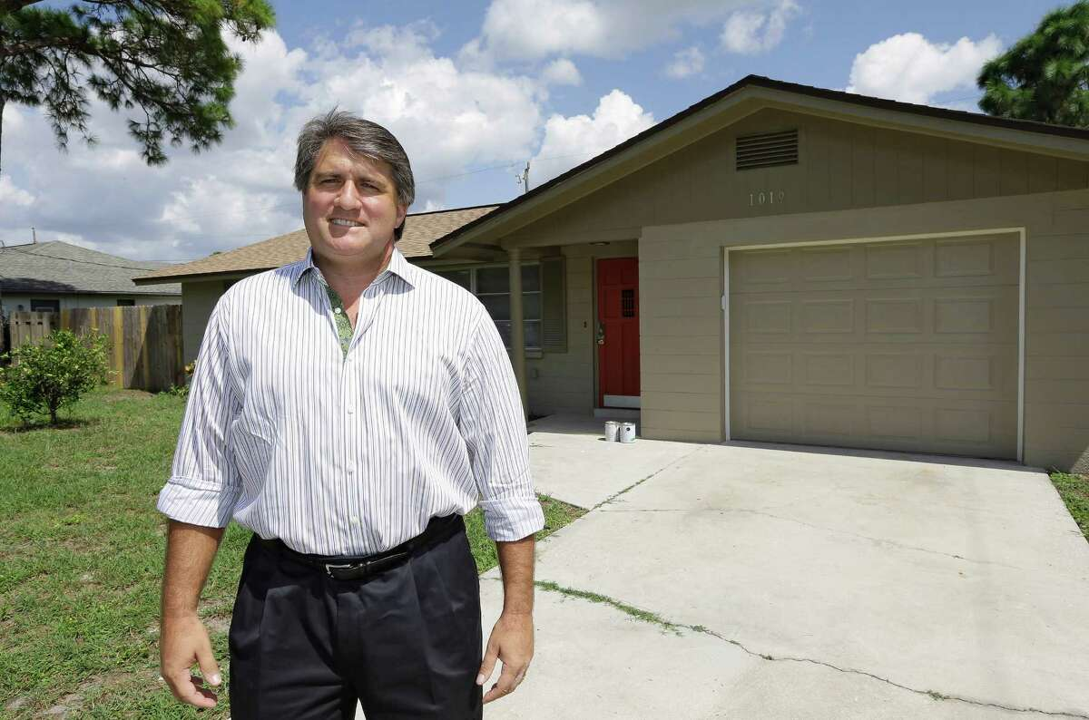 In this Sept. 12, 2012, photo, Andrew Neitlich poses in front of one his investment homes in Venice, Fla. Neitlich once worked as a financial analyst picking stocks for a mutual fund. During the dot-com crash 12 years ago, Neitlich didn't sell his stocks, but like many others he is selling now. An analysis by The Associated Press finds that individual investors have pulled at least $380 billion from U.S. stock funds since they started selling in April 2007. (AP Photo/Chris O'Meara)