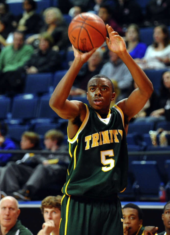 Trinity Catholic's #5 Brandon Wheeler attempts a thre pointer, during Northeast Christmas Classic basketball tournament action against LaSalle Acadeny at the Webster Bank Arena in Bridgeport, Conn. on Thursday December 27, 2012. Photo: Christian Abraham
