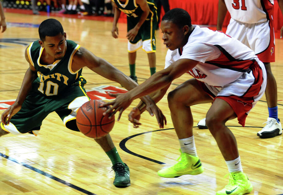 LaSalle Academy's #13 Markus Ross tries to steals away the ball from Trinity Catholic's #10 Neno Merritt, during Northeast Christmas Classic basketball tournament at the Webster Bank Arena in Bridgeport, Conn. on Thursday December 27, 2012. Photo: Christian Abraham