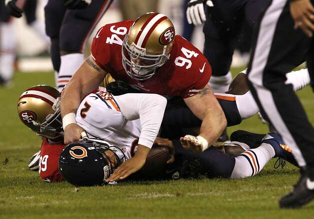 Defensive tackle Justin Smith (94) and Linebacker Aldon Smith (99) take down Chicago Bears quarterback Jason Campbell (2) during the first quarter of the San Francisco 49ers game against the Chicago Bears at Candlestick Park in San Francisco, Calif., on Sunday November 19, 2012. Photo: Carlos Avila Gonzalez, The Chronicle