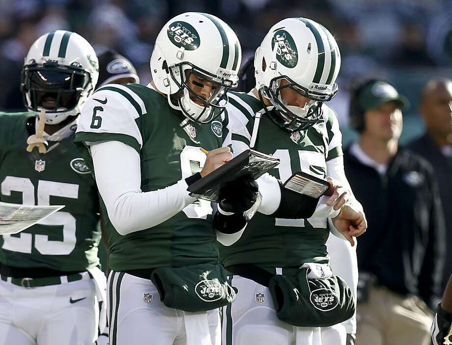 Mark Sanchez (6) - and not Tim Tebow (15) - will be back under center for the Jets on Sunday. Photo: Jeff Zelevansky, Getty Images