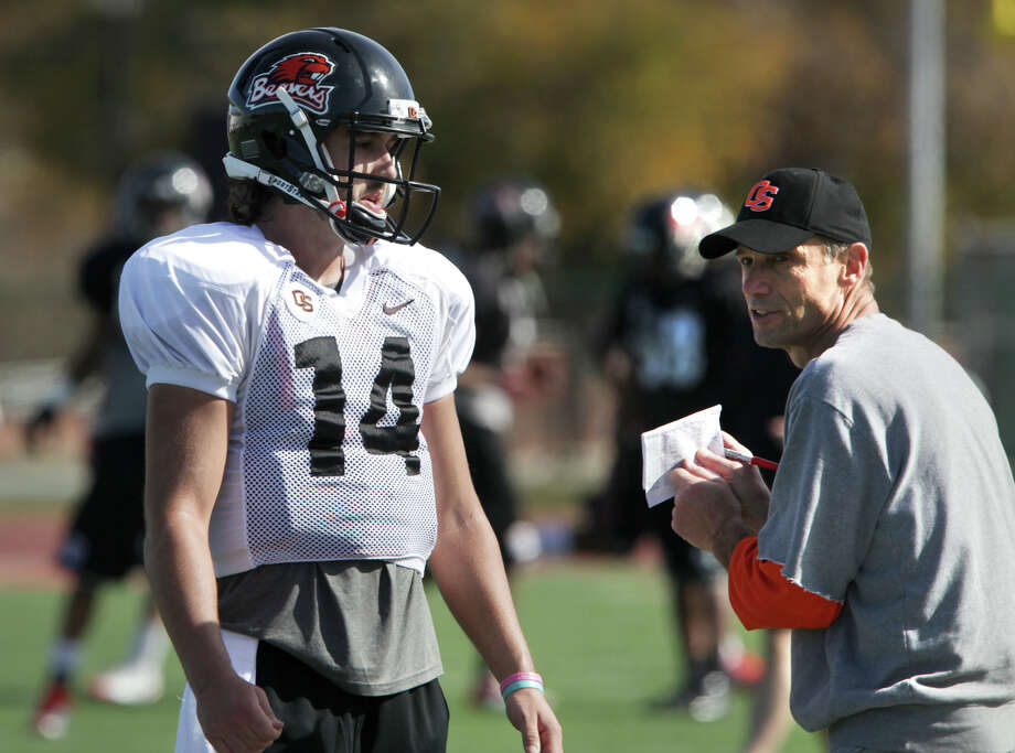 Oregon State Beavers Head Coach Mike Riley, right, talks to quarter back Cody Vaz, during practice at Benson Stadium, University of the Incarnate Word.  Monday, Dec. 24, 2012. Photo: Bob Owen, San Antonio Express-News / © 2012 San Antonio Express-News