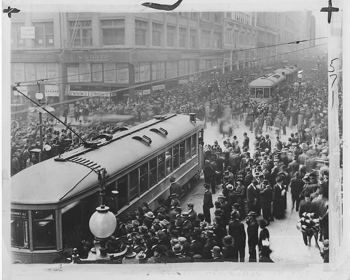 Riders gather for the first day of MUNI service, December 28, 1912.