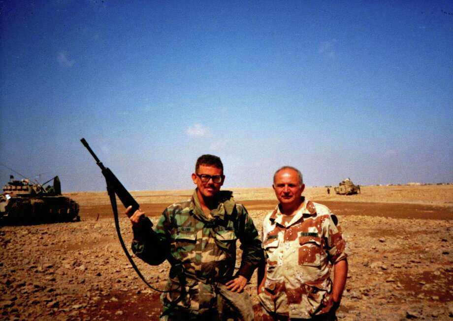 Mike Glenn, left, now a Chronicle reporter,  fought in the Persian Gulf War as an artillery officer assigned to the 3rd Armored Cavalry Regiment, then based at Fort Bliss. With him is the unit's chaplain. (Handout photo) / handout print