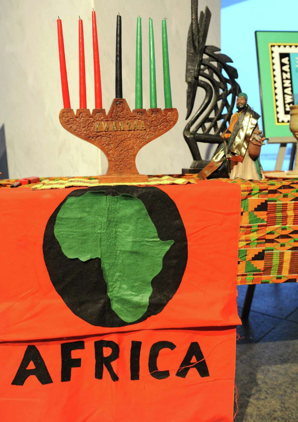 A table displays Kwanzaa items such as this kinara that has seven candles for the seven days of Kwanzaa at the Annual Capital Kwanzaa event at the New York State Museum on Thursday Dec. 27, 2012 in Albany, N.Y. (Lori Van Buren / Times Union)