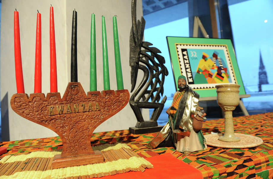 A table displays Kwanzaa items such as this kinara that has seven candles for the seven days of Kwanzaa at the Annual Capital Kwanzaa event at the New York State Museum on Thursday Dec. 27, 2012 in Albany, N.Y. (Lori Van Buren / Times Union) Photo: Lori Van Buren