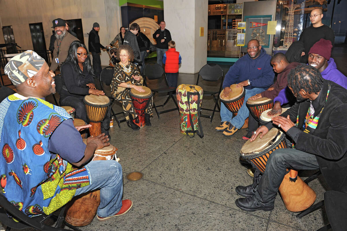 Zorkie Nelson, left, leads a drumming circle at the Annual Capital Kwanzaa event at the New York State Museum on Thursday Dec. 27, 2012 in Albany, N.Y. (Lori Van Buren / Times Union)