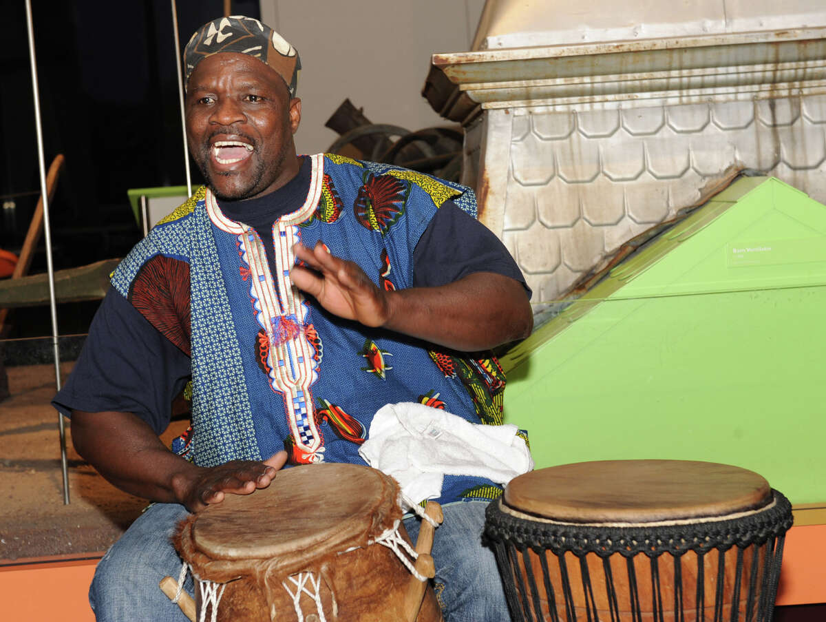 Zorkie Nelson of Schenectady leads a drumming circle at the Annual Capital Kwanzaa event at the New York State Museum on Thursday Dec. 27, 2012 in Albany, N.Y. (Lori Van Buren / Times Union)