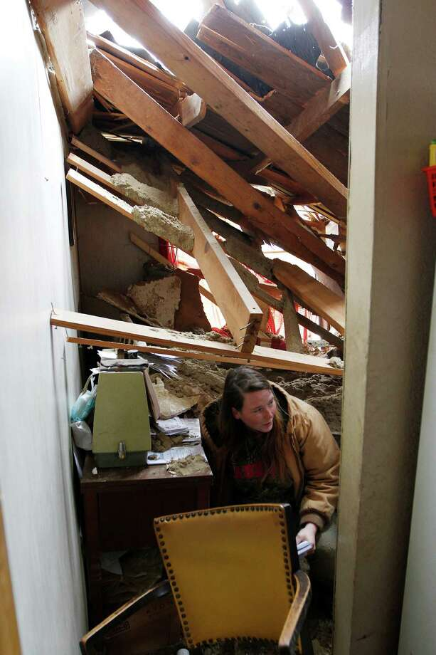 Audrey Boykin salvages items from a home that was smashed by a tree in Centreville, Miss. No one was home at the time the tree fell. About 70 homes in the state suffered storm-related damage. Photo: Philip Hall, MBO / Enterprise-Journal