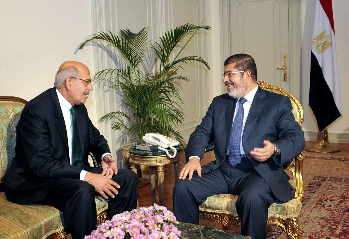 FILE - In this Tuesday, Nov. 13, 2012 file photo, released by the Egyptian Presidency, Nobel Peace Prize winner and head of the opposition Egyptian Constitution political party, Mohamed ElBaradei, left, meets with Egyptian President Mohammed Morsi, in Cairo, Egypt. An Egyptian official says the country?'s top prosecutor has ordered an investigation into accusations against opposition leaders, Mohammed ElBaradei, Amr Moussa, and Hamdeen Sabahi, of inciting the overthrow of Egypt's first elected president, Mohammed Morsi. (AP Photo/Egyptian Presidency, File)