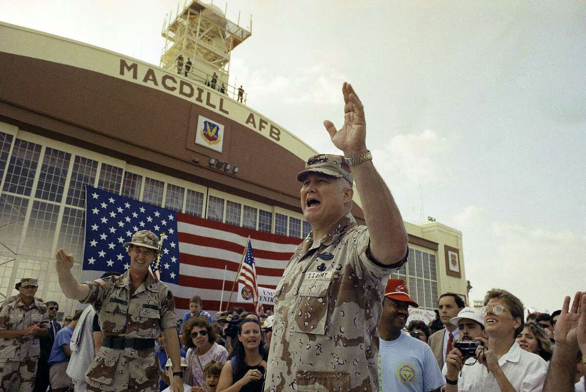 FILE - In this April 22, 1991 file photo, General H. Norman Schwarzkopf waves to the crowd after a military band played a song in his honor at welcome home ceremonies at MacDill Air Force Base in Tampa, Fla. Schwarzkopf died Thursday, Dec. 27, 2012 in Tampa, Fla. He was 78. (AP Photo/Lynne Sladky, File)
