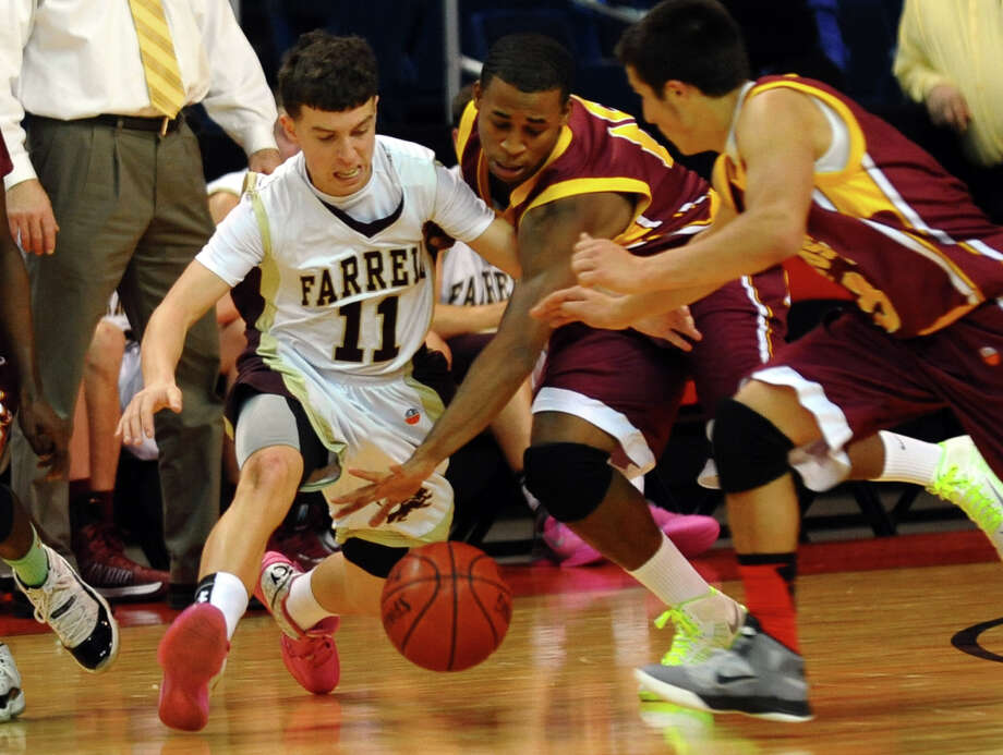 St. Joseph's #15 Denzel Moscova, center, and teammate #3 Jake Pelletier try to steal a loose ball away from Monsignor Farrell's #11 Connor Nicholson, during Northeast Christmas Classic basketball tournament at the Webster Bank Arena in Bridgeport, Conn. on Thursday December 27, 2012. Photo: Christian Abraham / Connecticut Post