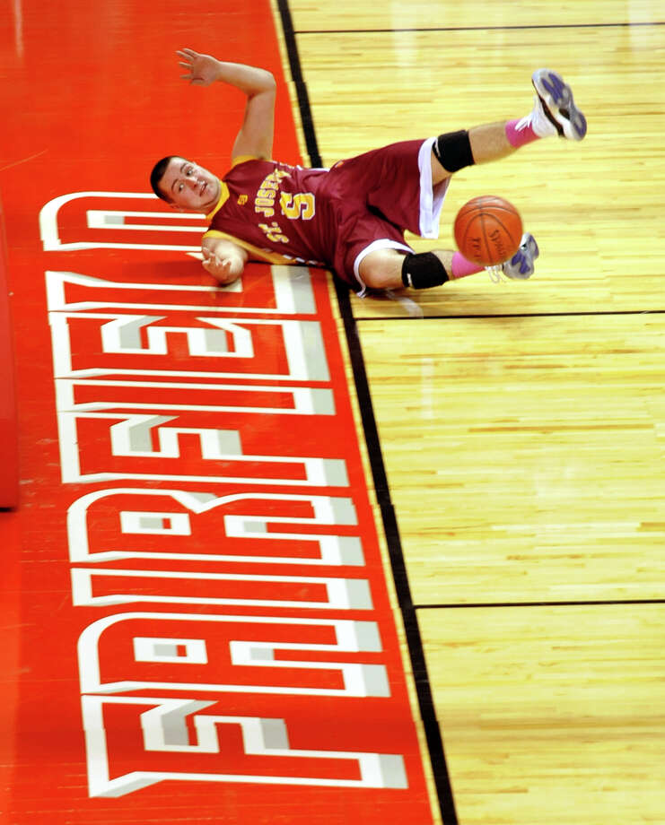 St. Joseph's #5 Jonathan Dzurenda slides out of bounds trying to keep the ball in play, during Northeast Christmas Classic basketball tournament action against Monsignor Farrell at the Webster Bank Arena in Bridgeport, Conn. on Thursday December 27, 2012. Photo: Christian Abraham / Connecticut Post