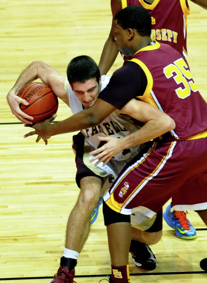 St. Joseph's #35 Erick Langston puts pressure on Monsignor Farrell's #44 Thomas Vazzana, during Northeast Christmas Classic basketball tournament at the Webster Bank Arena in Bridgeport, Conn. on Thursday December 27, 2012. Photo: Christian Abraham / Connecticut Post