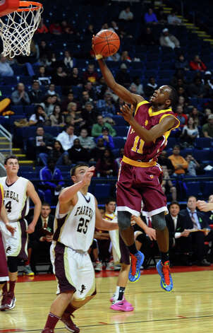 St. Joseph's #11 Quincy McKnight attempts a lay up, during Northeast Christmas Classic basketball tournament action against Monsignor Farrell at the Webster Bank Arena in Bridgeport, Conn. on Thursday December 27, 2012. Photo: Christian Abraham / Connecticut Post