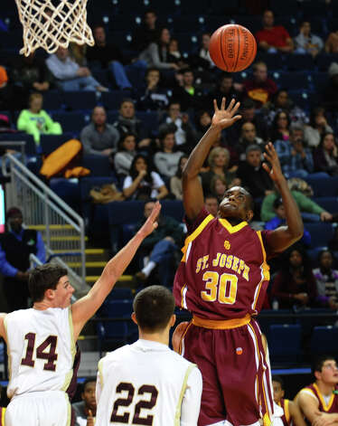 St. Joseph's #30 Raekwon Reid releases a shot, during Northeast Christmas Classic basketball tournament action against Monsignor Farrell at the Webster Bank Arena in Bridgeport, Conn. on Thursday December 27, 2012. Photo: Christian Abraham / Connecticut Post