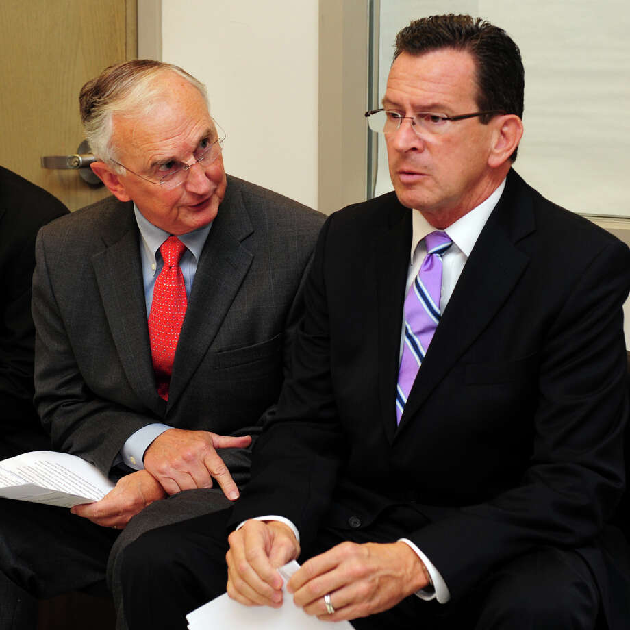 Former Board of Regents President Robert Kennedy speaks with Gov. Dannel Malloy during a tour of Housatonic Community College's new Regional Advanced Manufacturing Center Wednesday, Oct. 3, 2012. Photo: Autumn Driscoll / Connecticut Post