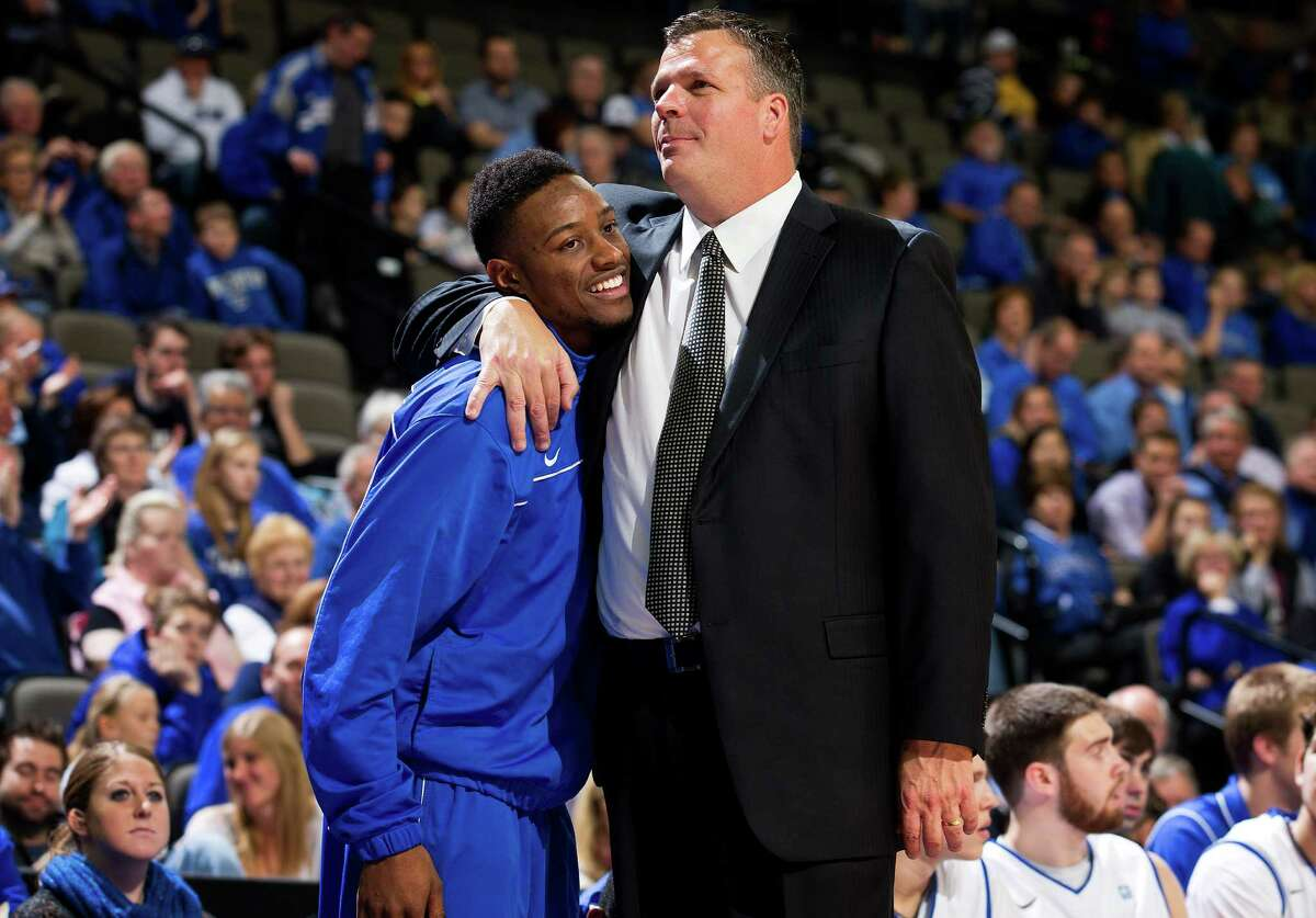 FILE - In this Dec. 9, 2012, file photo, Creighton head coach Greg McDermott hugs senior Josh Jones, who did not play due to a health issue, during a NCAA college basketball game at the CenturyLink Center Omaha, Neb. Jones had surgery on Dec. 18 to fix a problem that caused him to faint before the game at Nebraska 12 days earlier. He had an infected heart valve in 2007, when he was a senior in high school. McDermott said Wednesday night, Dec. 26, 2012, that doctors advised Jones to give up basketball. (AP Photo/The World-Herald, Rebecca S. Gratz) MAGS OUT; ALL NEBRASKA LOCAL BROADCAST TV OUT
