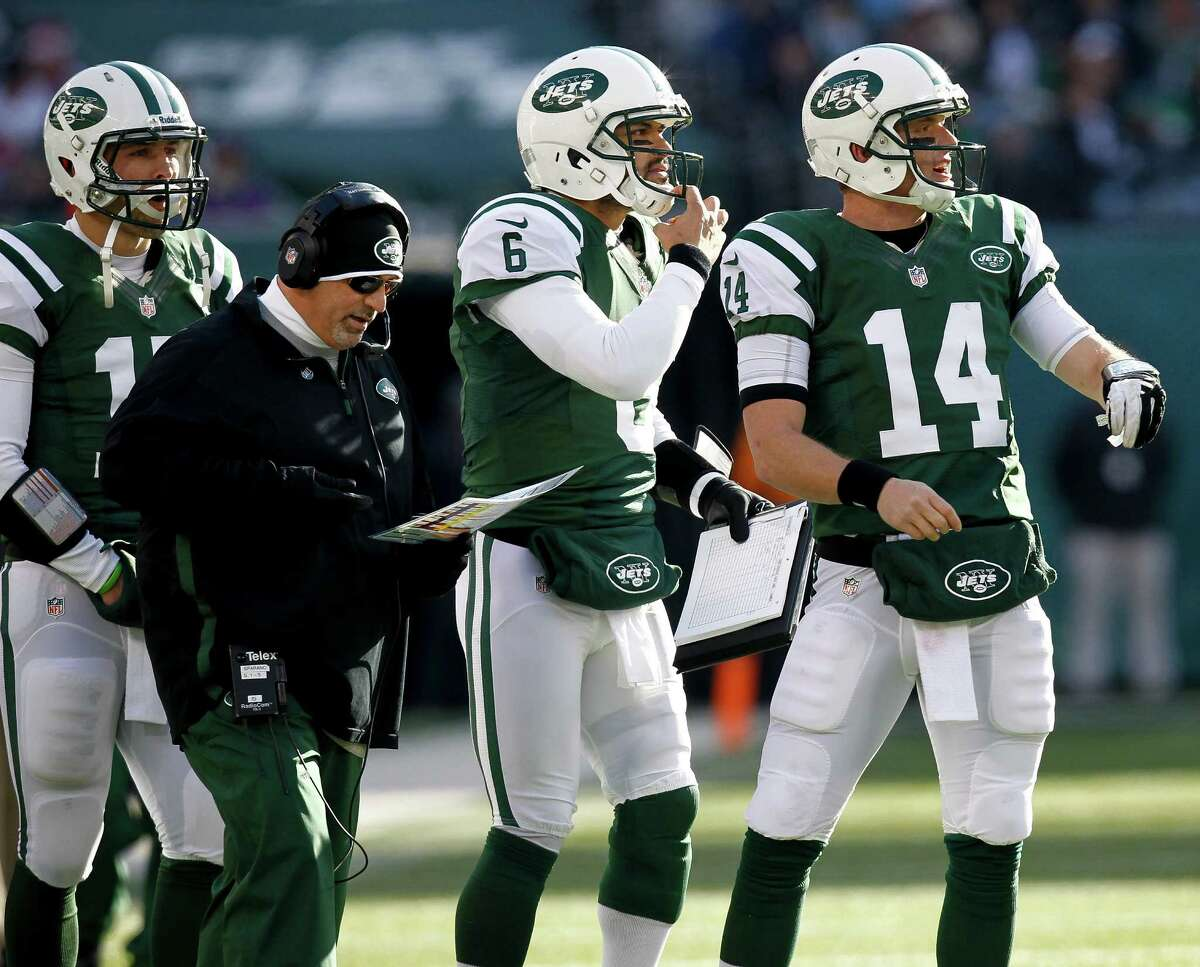 EAST RUTHERFORD, NJ - DECEMBER 23: Mark Sanchez #6, Greg McElroy #14 and Tim Tebow #15 of the New York Jets, surround Tony Sparano, offensive coordinator during their game against the San Diego Chargers at MetLife Stadium on December 23, 2012 in East Rutherford, New Jersey. (Photo by Jeff Zelevansky/Getty Images)