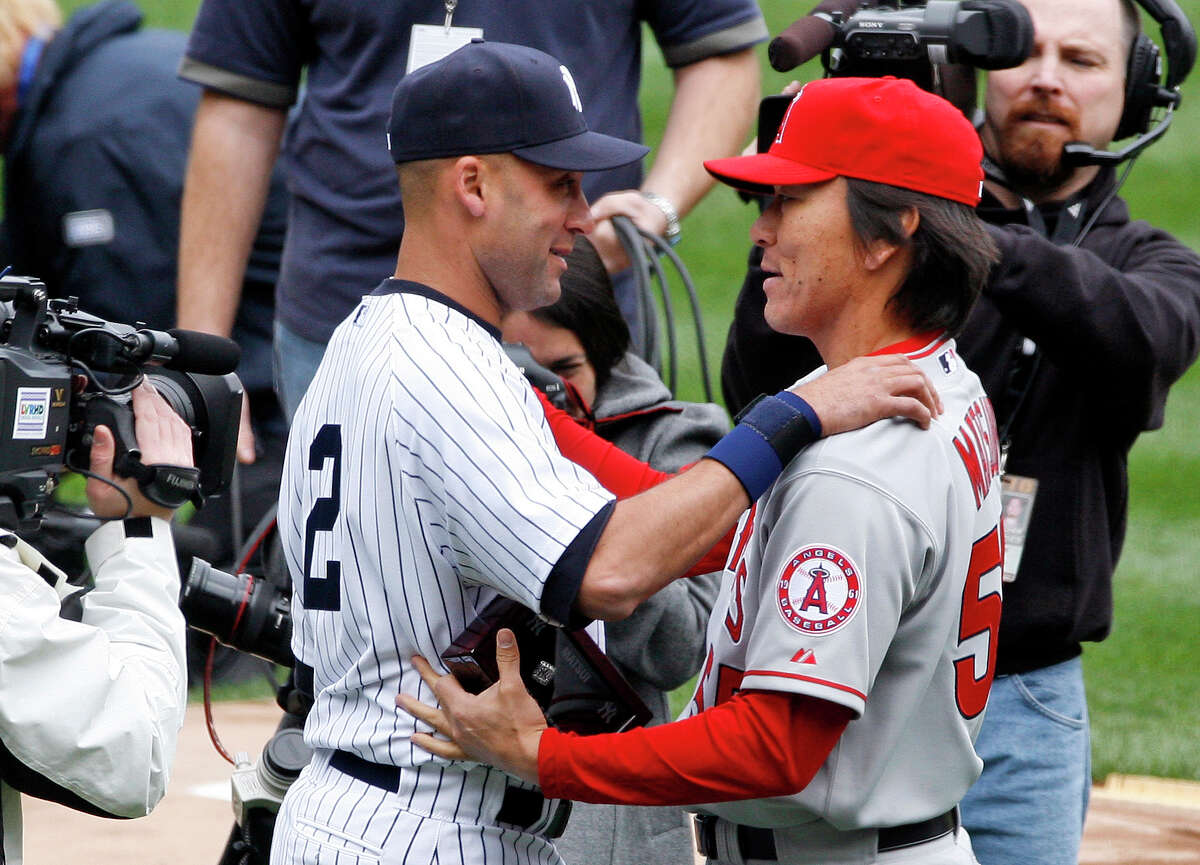 FILE - In this April 13, 2010, file photo, Los Angeles Angels' Hideki Matsui, right, greets former teammate New York Yankees captain Derek Jeter after accepting his 2009 World Series ring during a pregame ceremony before a baseball game at Yankee Stadium in New York. The 38-year-old former New York Yankees' outfielder, World Series MVP, and two-time All Star announced his retirement from baseball on Thursday, Dec. 27, 2012, following months of free agency after his release from the Tampa Bay Rays in August. (AP Photo/Peter Morgan, File)