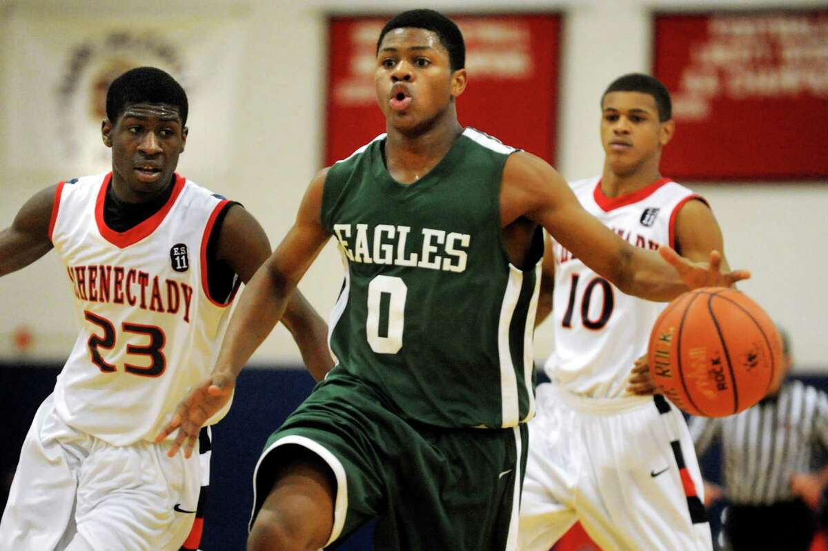 Green Tech's Jajee Ward (0), center, charges up court as Schenectady's Johnson Gooden-Prunty (23), left, and Clarence Stanford (10) defend during their basketball game on Thursday, Dec. 27, 2012, at Schenectady High in Schenectady, N.Y. (Cindy Schultz / Times Union)