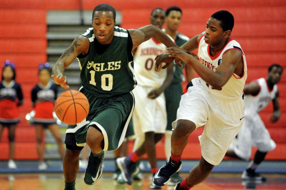 Green Tech's Maurice West (10), left, drives up court as Schenectady's Towan Hamlin (15), right, defends during their basketball game on Thursday, Dec. 27, 2012, at Schenectady High in Schenectady, N.Y. (Cindy Schultz / Times Union)