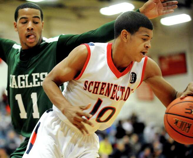 Schenectady's Clarence Stanford (10), right, drives past Green Tech's Jizziah Carr (11) during their
